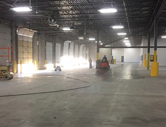 Large warehouse getting cleaning